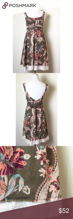 Lovely cotton boho summer dress Brown floral empire waist dress with long wrap around attached belt. Eyelet lace trim. Hidden side zipper. Excellent like new condition. Free People Dresses