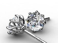 Mark Morrell strikes again... Diamond earring studs in what looks like an adapted Flame setting