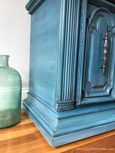 Goodwill accent table gets a makeover. See how to paint furniture with layers on this ornate vintage cabinet in shades of blue