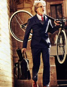 By far the best use of a bike as an accessory. This whole shoot looks awesome, and I just love the concept of an older, well-dressed man retaining some youthful exuberance. Plus, he's carrying that bike like a boss.