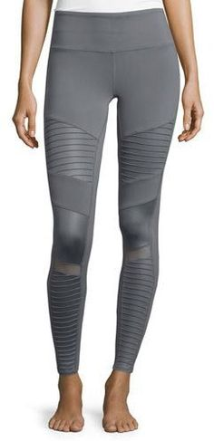 87be008e2afe87 Alo Yoga moto-style performance leggings in mixed matte/shine fabric.  Hidden key/card pocket in waistband. Mesh detail below knee.