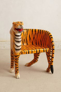 Handcarved Bengal Chair #anthropologie #anthrofave - perfect for my office. go MEMPHIS tigers!