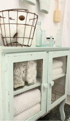 Mint Color Painted Bathroom // Love the Toilet Paper Basket Idea