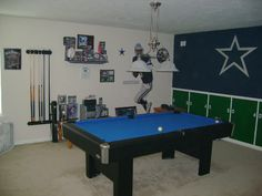 Dallas Cowboys theme pool room with a Brunswick Black Wolf pool table