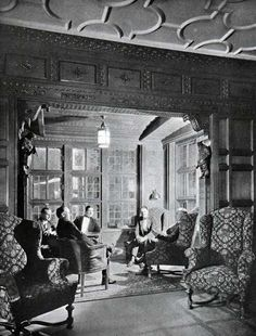 A corner of the Smoking Room on the S.S. Leviathan of the United States Lines, passengers gather for a pleasant chat. The chairs are leather and tapestry covered. In this era (1923) [and prior], only men occupied the smoking rooms of the great steamships.