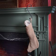 Hand-forged stocking hangers from our B. 1802 blacksmith.  Sturdy enough to hold even the most stuffed stocking and like everything at Beekman 1802, meant to last for generations  http://shop.beekman1802.com/collections/all-goods/products/iron-stocking-mantle-hanger