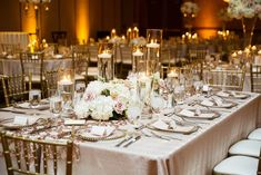 This blush and sequin themed wedding is both glamorous and romantic.  Floating candles paired with white floral and glass beaded charger plates finish this beautiful wedding reception look.