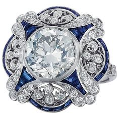 4.63ct Center Diamond Sapphire ring | From a unique collection of vintage cocktail rings at https://www.1stdibs.com/jewelry/rings/cocktail-rings/
