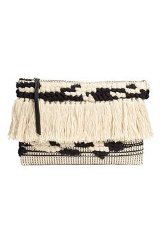 Jacquard-weave clutch bag: Sturdy, jacquard-weave clutch with fringes at the front, a zip at the top, one inner compartment and a twill lining. Size 21x30 cm.