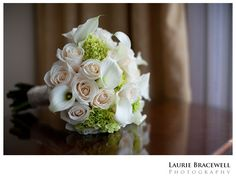 Ivory roses, white calla lilies, green hydrangea and photo by Laurie Bracewell