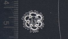 tiny motif using Coron Cotton size 160 thread.  by Mark, aka Tatman:  http://www.tat-man.net