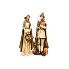 Dress up your favorite Harvest table with our elegant pilgrim couple. They are a set of two and include traditional fall decorations like pumpkins and gourds. A great way to show the Thanksgiving spirit in your home.