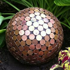 Bowling ball covered in pennies.
