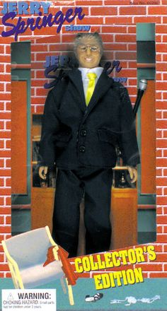 """There was a brief time when Jerry Springer was both popular and deemed somewhat wholesome--before he effectively created the genre of """"watching ugly, stupid people behaving terribly,"""" a.k.a. reality television. Even during those 3-4 days, it's hard to imagine who would want a Jerry Springer doll, or why. However, the toymakers did capture his likeness perfectly—its smarmy, grinning head sculpt is exactly how Springer looks when his guests start screaming and swinging at each other."""