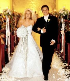 c6f0456da9230 Jessica Simpson & Nick Lachey looking incredibly happy. The bride was  wearing a custom made white strapless beaded Vera Wang gown and veil.