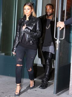 His 'n' hers: Kim Kardashian and Kanye West wore matching leather as they left their hotel in New York on Sunday