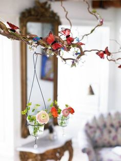 Make a hanging from corkscrew hazel or willow and hang small glass flower/tealight containers