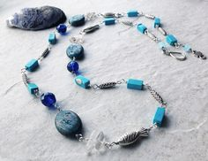 Great blue necklace for the beach or the next fun casual party! Genuine Quartz and Blue Sky Jasper with Chalk turquoise and pewter. Wire wrapped individually with silver plated copper wire. Pewter …