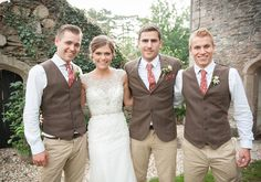 The groomsmen: Dark brown tweed jackets, cream chinos, waistcoats, white shirts and red floral ties. Perfect for a rustic countryside wedding