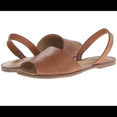 MIA Palma Sandal Luggage Vegan This slip-on is sure to be the ninja in your current wardrobe. It will silently sidestep any fashion faux pas and complete a killer ensemble. Flat silhouette with slight heel. Elastic gored strap at heel for secure fit. Smooth man-made upper. Synthetic ventilated lining with lightly cushioned footbed. Durable man-made outsole.                                                                                                   *Brand New with Box MIA Shoes Sandals