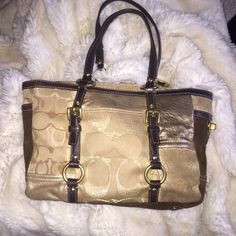 Coach handbag This is a preloved authentic Coach handbag! This bag does have a few stains. The bottom corners of the bag got darker over time and the inside of the bag has some makeup stains. Overall very pretty gold and brown bag! Make an offer. :) Coach Bags Shoulder Bags