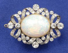 An Edwardian opal and diamond brooch