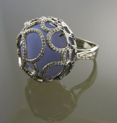 LST02109 An 18k white gold ring set with an encaged 18mm round Chalcedony drusy cabachon and 167 round full cut diamonds G to H color and VS clarity .41 total carat weight. Designed and made by llyn strong.
