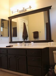 There are a ton of tutorials out there on how to frame a plate glass bathroom mirror using trim molding mitered on the corners, but I'm ...