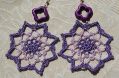 Eight pointed star crochet earrings. In violet color.