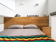 Dwell - The Manhattan Transformation To maximize space, both sides of the bed are outfitted with wall sockets and reading lights.