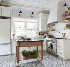 Small Kitchen Remodeling BECKI OWENS- Pros and Cons: Kitchen Flooring - See beautiful inspiration shots and learn the pros and cons of choosing tile, concrete, or wood kitchen floors before you start your own kitchen refresh. Farmhouse Kitchen Decor, Kitchen Redo, New Kitchen, Kitchen Dining, Kitchen Ideas, Kitchen Cabinets, Modern Farmhouse, Kitchen Cart, Kitchen Island
