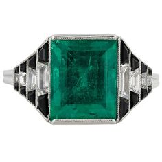 Art Deco Onyx 4.36 carat Emerald Diamond  Ring | From a unique collection of vintage cocktail rings at https://www.1stdibs.com/jewelry/rings/cocktail-rings/