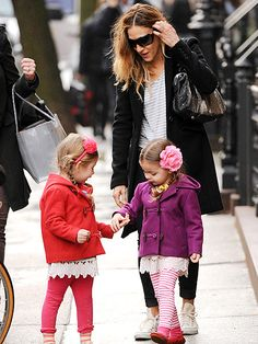 In a show of sisterly love, Sarah Jessica Parker's 3-year-old twins, Loretta and Tabitha, hold hands on their way to school in New York City on Wednesday, January 2013.