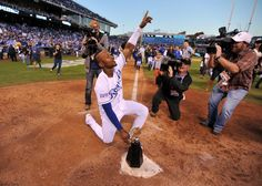 Oct 15, 2014; Kansas City, MO, USA; Kansas City Royals outfielder Jarrod Dyson (1) celebrates with the American League championship trophy after game four of the 2014 ALCS playoff baseball game against the Baltimore Orioles at Kauffman Stadium. The Royals swept the Orioles to advance to the World Series. (Peter G. Aiken-USA TODAY Sports)