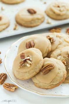These Brown Sugar Pecan Cookies are soft, buttery, brown sugar cookies topped with brown sugar frosting and more pecans -- perfect for Christmas baking or any day of the year! Includes step by step recipe video   sugar cookies   soft cookies   Christmas c