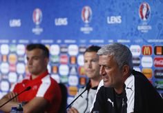 Head Coach Vladimir Petkovic of Switzerland talks to the media as players Xherdan Shaqiri (L) and Stephan Lichtsteiner listen during the Switzerland Press Conference at the Stade Bollaert-Delelis on June 10, 2016 in Lens, France. (Photo by Handout/UEFA via Getty Images)..Picture credit: UEFA (Handout photo provided by UEFA. Only editorial use relating to the event described is permitted. Photo may be distributed to third parties to use for the same purpose provided that no charge is made).