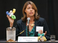 Erica Ollmann Saphire at Scripps event showing a model of the Ebola surface protein (white) with three ZMapp antibodies attached.