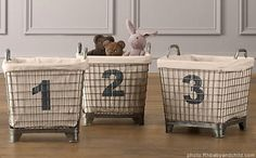 metal baskets with canvas stenciled numbered liners...I can do that