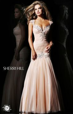 Sherri Hill 21069 is a mermaid dress fit for a pageant queen! This simple look hugs the body in the perfect prom like way. A mermaid skirt is always a hit! The deep V sweetheart neckline features a slight embellishment. The layered skirt gives off an hourglass shape.