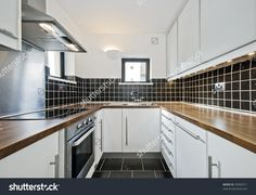 white kitchen dark wood worktop modern - Hledat Googlem