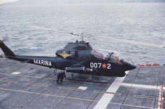 Spain's Navy AH-1G Huey Cobra over the deck of the aircraft carrier SPS Dédalo R-01 (former USS Cabot CVL-28).