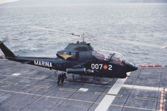 Spain's Navy AH-1G Huey Cobra over the deck of the aircraft carrier SPS Dédalo R-01 (former USS Cabot CVL-28).