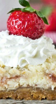 Strawberry Shortcake Cheesecake Bars Recipe ~  They have a golden Oreo crust, strawberry swirled cheesecake and an amazing streusel on top. Serve with strawberries and whipped cream!