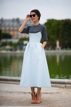 grey sweatshirt under a feminine fit and flare midi dress + peach ankle boots