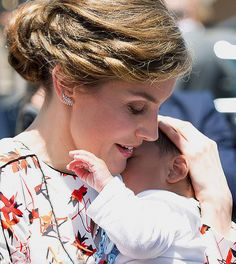 Spain's Queen Letizia shows off her maternal side as she cradles a newborn baby during a visit to the Canary Islands on April 24, 2017