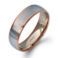 Featuring a modern twist on the classic wedding band design, this contemporary white gold mens wedding band has an eye-catching rose gold outline. Simon G LG116 #arthursjewelers