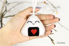 Christmas ornament felt onigiri Funny felt onigiri Christmas ornament Its soft and you cane use it to decorate your Christmas tree and your home. Make your Christmas special with this beautiful handmade felt ornament. You can choose between ornament or keychain ( shorter ribbon and metal