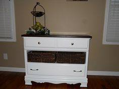 I like this as a dresser makeover idea. Esp. if there is a broken drawer. Some paint, new hardware, a couple baskets and bam a new piece!