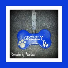 Perfect for the #1 Dodger Fan in your life and their loving pup. This Dodger Dog bone ornament can be personalized with the name of your choice. Size is as follows: 2 inches tall by 3 1/4 wide. Personalized Dodger Dog Bone Ornament by KeepsakesByNicolina, $8.00 www.Facebook.com/KeepsakesByNicolina