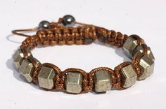 Pyrite bracelet for men made with stones in the shape of nut The stones are placed on a solid brown color polyester thread 2 pearls Hematite chips are at the end of cord Width approximately cm The bracelet is adjustable The bracelet will be sent randomly Crane, Beaded Bracelets, Etsy, Jewelry, Fashion, Male Jewelry, Man Bracelet, Skull, Unique Jewelry